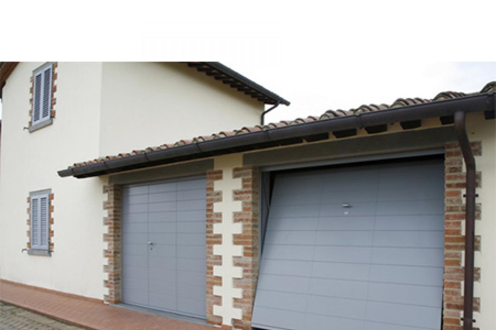Lines porta basculante linea legno porte basculanti - Prezzo porta basculante garage ...